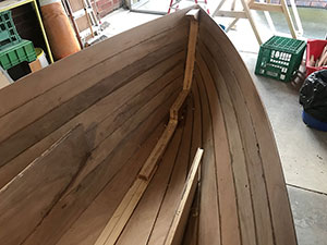 The forward bulkhead removed on our B&B Yacht Designs Lapwing 16. Removing this bulkhead was one of the major changes to the supplied plans.